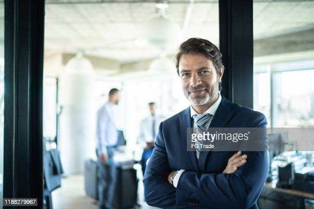 portrait of a confident businessman - one mature man only stock pictures, royalty-free photos & images