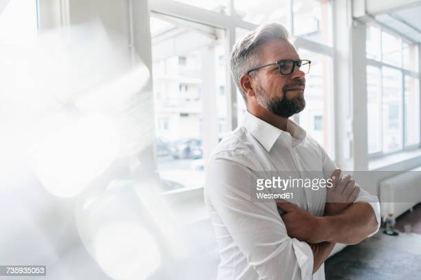 portrait of a confident businessman - bold man stock photos and pictures