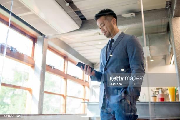 Portrait of a confident businessman using a smartphone