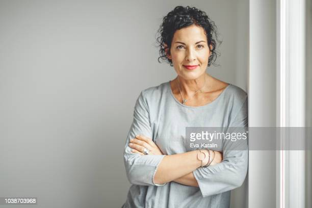 portrait of a confident businesswoman - mid adult stock pictures, royalty-free photos & images