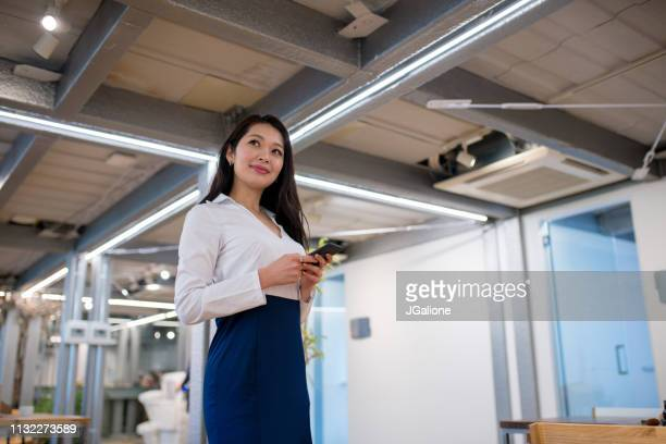 portrait of a confident japanese businesswoman - east asian ethnicity stock pictures, royalty-free photos & images
