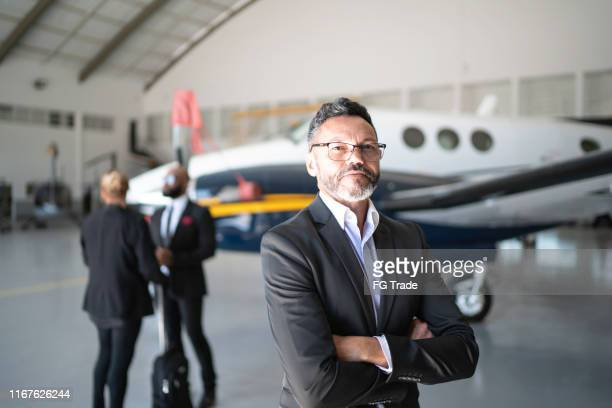 portrait of a confident man in a hangar - chairperson stock pictures, royalty-free photos & images