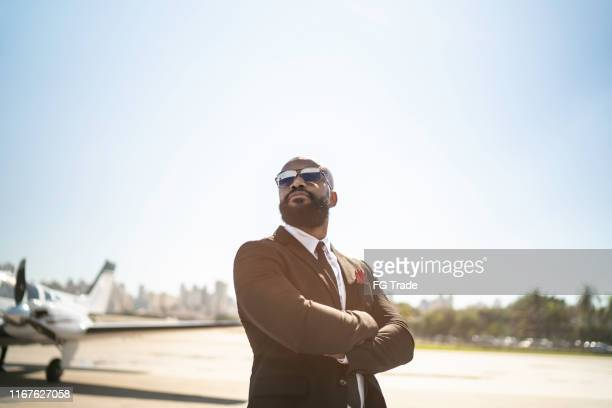 portrait of a confident man looking away in a hangar - best sunglasses for bald men stock pictures, royalty-free photos & images