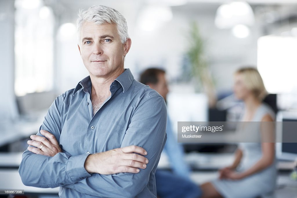 Portrait of a confident man with his arms crossed : Stock Photo