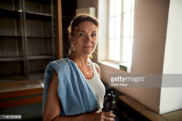 portrait of a confident mature woman in a health club - locker room stock pictures, royalty-free photos & images
