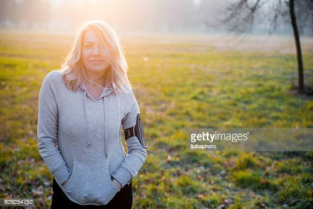Portrait of a confident sports mature woman smiling outdoors