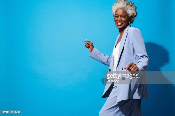 portrait of a confident, successful, happy mature woman - confidence stock pictures, royalty-free photos & images