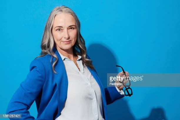 portrait of a confident, successful, happy mature woman - mature women stock pictures, royalty-free photos & images