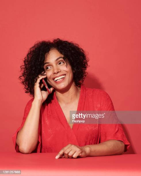 portrait of a confident, successful, happy mature woman - using phone stock pictures, royalty-free photos & images