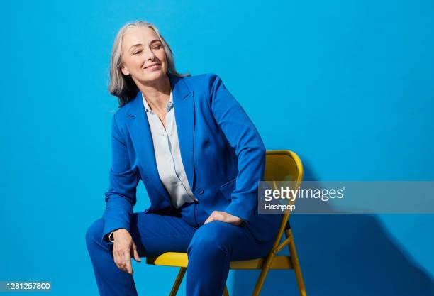 portrait of a confident, successful, happy mature woman - business person stock pictures, royalty-free photos & images