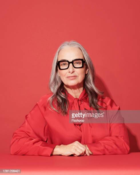 portrait of a confident, successful, happy mature woman - elegance stock pictures, royalty-free photos & images