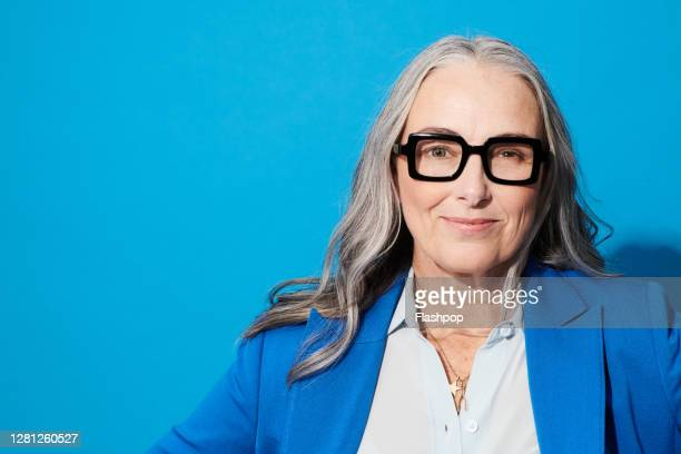 portrait of a confident, successful, happy mature woman - diversity stock pictures, royalty-free photos & images