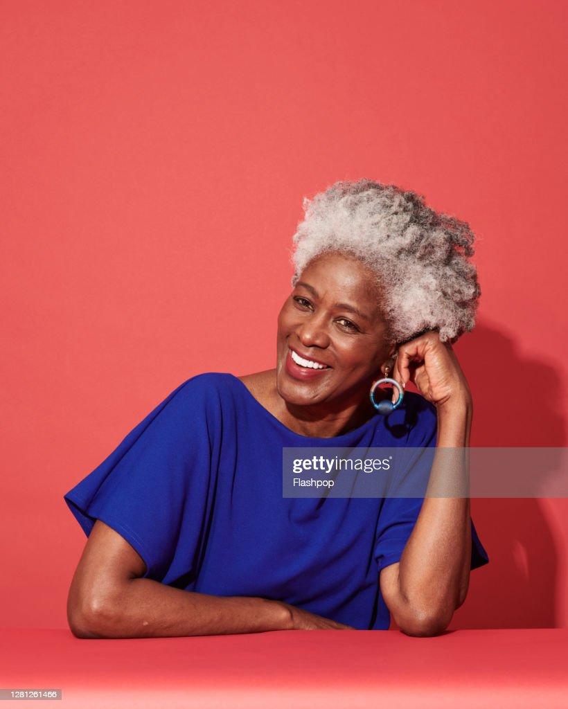 Portrait of a confident, successful, happy mature woman : Stock Photo