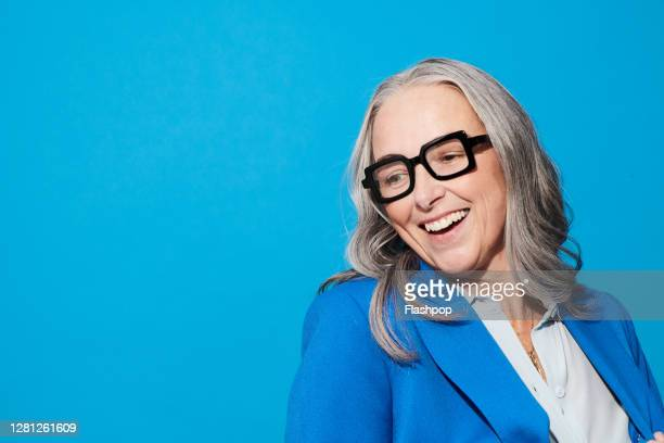 portrait of a confident, successful, happy mature woman - females stock pictures, royalty-free photos & images