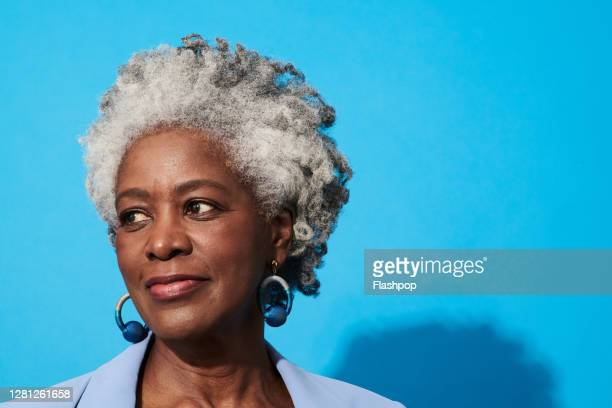 portrait of a confident, successful, happy mature woman - one woman only stock pictures, royalty-free photos & images