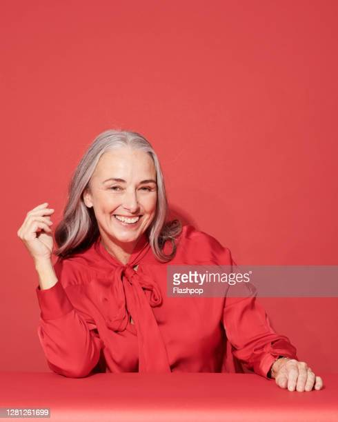 portrait of a confident, successful, happy mature woman - mature adult stock pictures, royalty-free photos & images