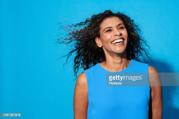 portrait of a confident, successful, happy mature woman - cheerful stock pictures, royalty-free photos & images
