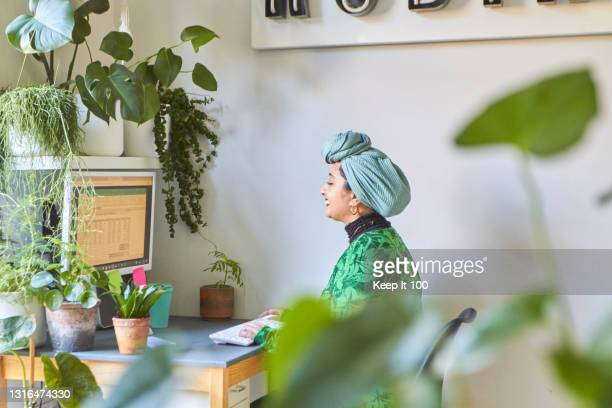 a portrait of a confident, successful woman - headwear stock pictures, royalty-free photos & images