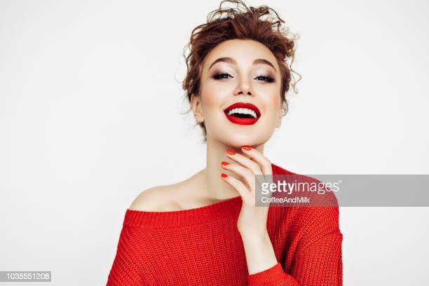 portrait of a confident woman in a red jumper - toothy smile stock pictures, royalty-free photos & images