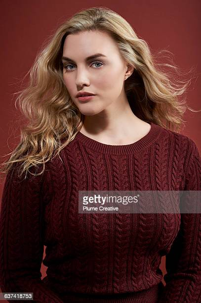 Portrait of a confident woman in a red jumper