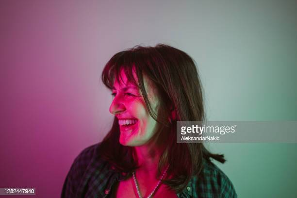 portrait of a confident woman under neon lights - lighting equipment stock pictures, royalty-free photos & images