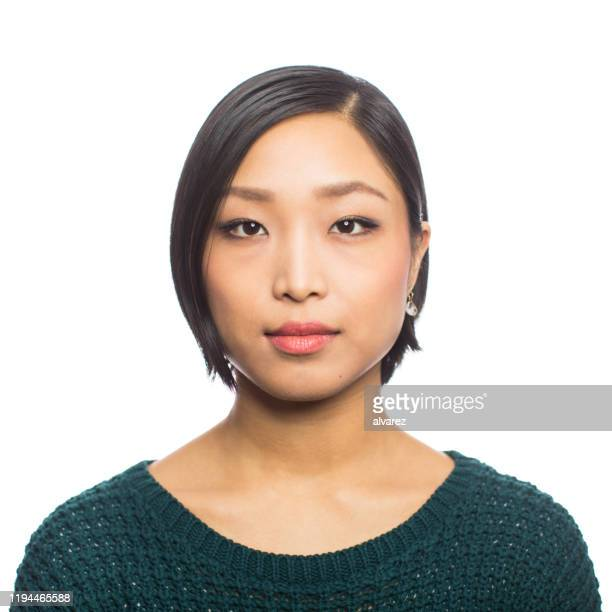 portrait of a confident young asian woman - human face stock pictures, royalty-free photos & images