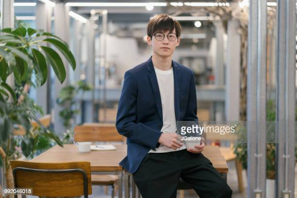 portrait of a confident young business man - handsome chinese men stock pictures, royalty-free photos & images