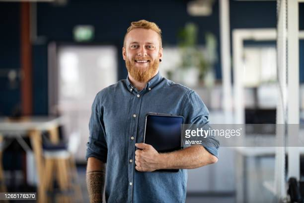 portrait of a confident young businessman - employee stock pictures, royalty-free photos & images