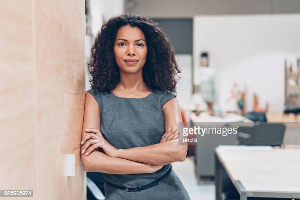 portrait of a confident young businesswoman - responsibility stock pictures, royalty-free photos & images