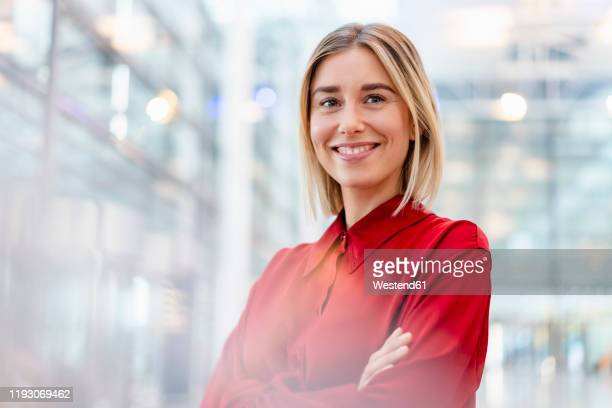 portrait of a confident young businesswoman wearing red shirt - red shirt stock pictures, royalty-free photos & images