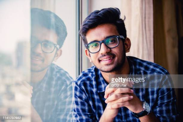 portrait of a confident young man - indian culture stock pictures, royalty-free photos & images