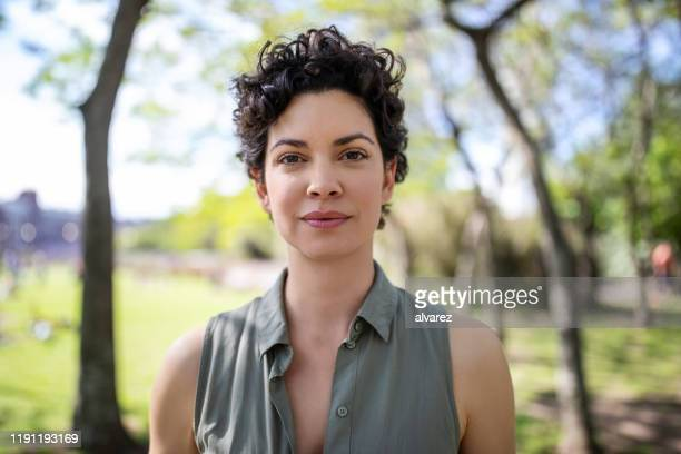 portrait of a confident young woman at the park - only women stock pictures, royalty-free photos & images