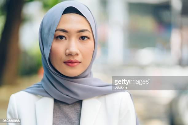Portrait of a confident young woman wearing a hijab