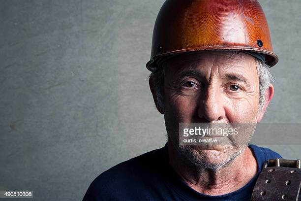 portrait of a construction worker - working seniors stock pictures, royalty-free photos & images