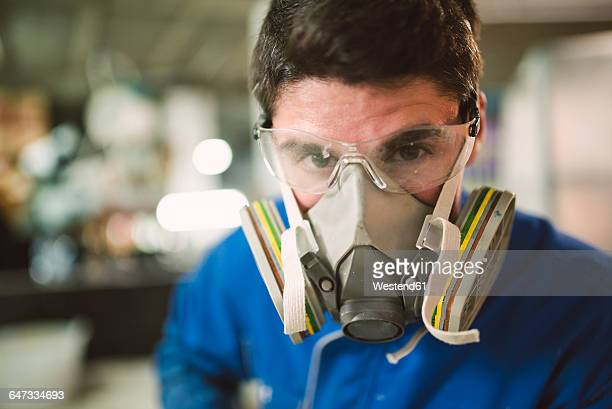 Portrait of a construction worker wearing a protective mask