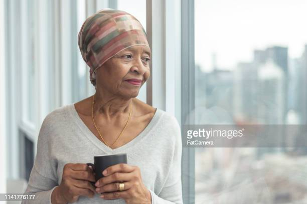 Portrait of a contemplative senior woman with cancer
