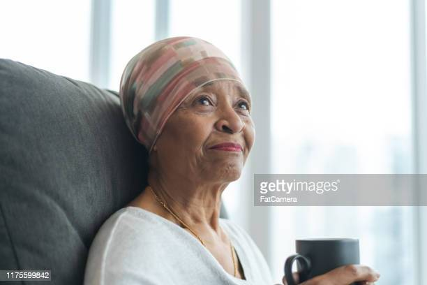 portrait of a contemplative senior woman with cancer - patient stock pictures, royalty-free photos & images