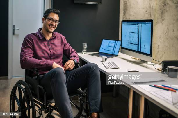 portrait of a content busienssman with differing abilities - assistive technology stock pictures, royalty-free photos & images