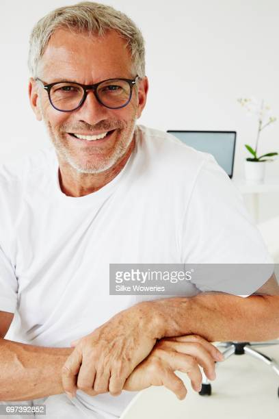 portrait of a content senior medical doctor at his practice