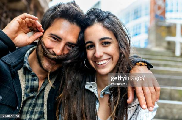 Portrait of a couple having fun in the city