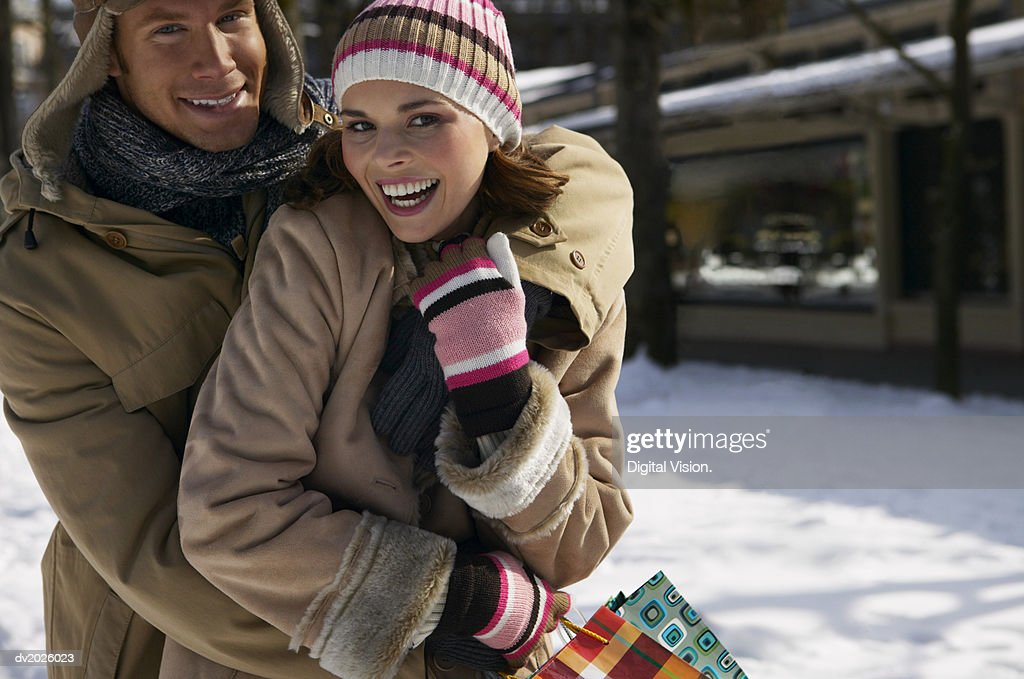 Portrait of a Couple in Winter Clothing Embracing : Stock Photo
