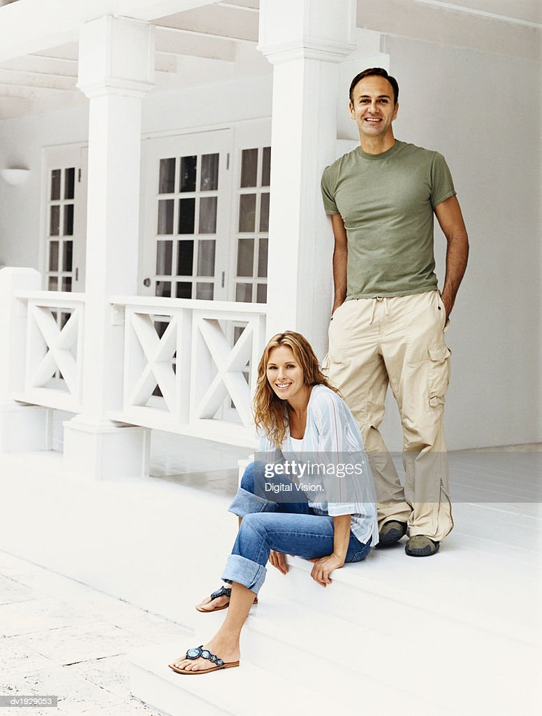 Portrait of a Couple on Their Porch : Stock Photo