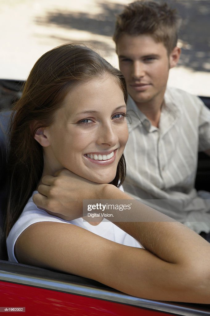 Portrait of a Couple Sitting in the Front Seat of a Convertible : Stock Photo