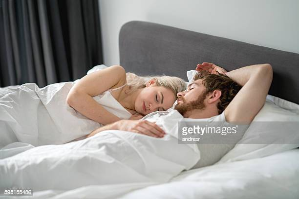 Portrait of a couple sleeping in bed