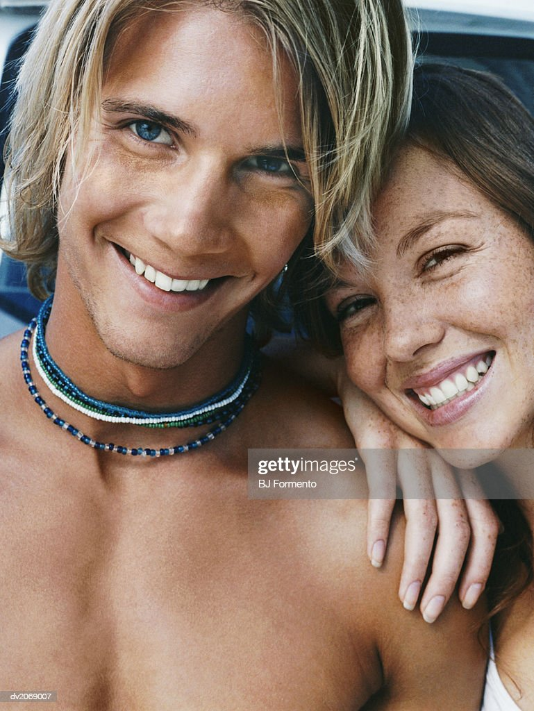 Portrait of a Couple Smiling, Man Wearing a Necklace : Stock Photo