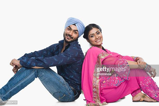 portrait of a couple smiling - salwar kameez stock photos and pictures