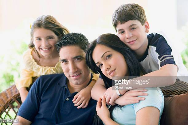Portrait of a couple smiling with their two children