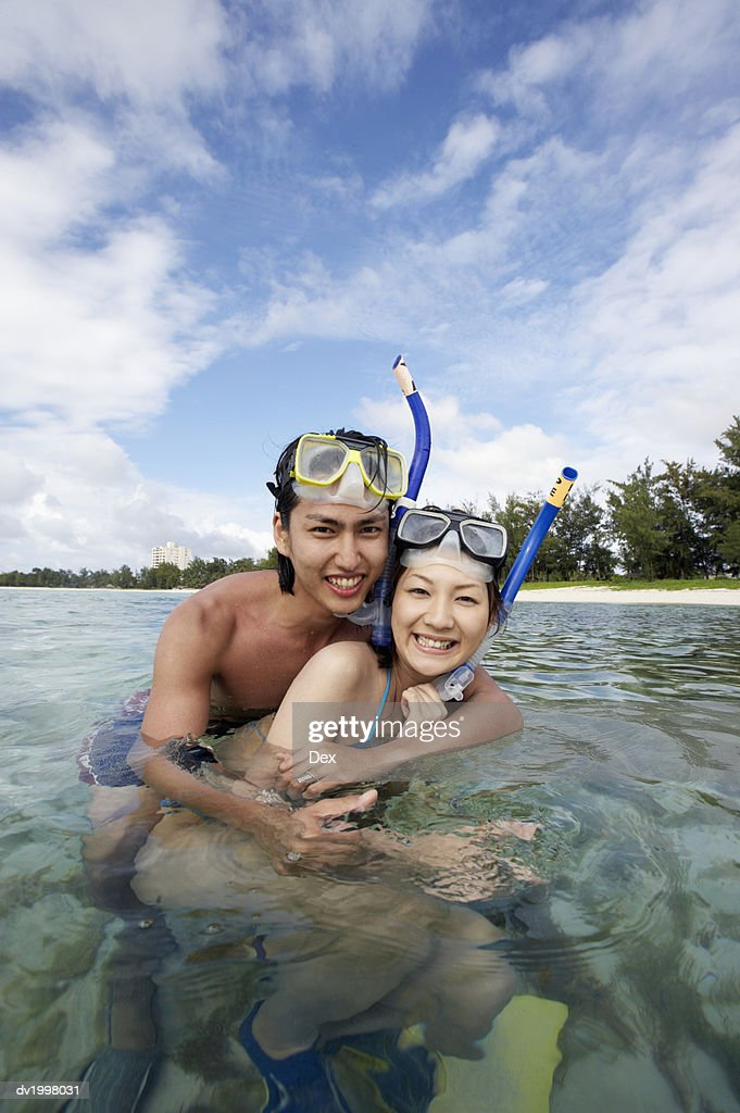 Portrait of a Couple Snorkeling in the Sea : Stock Photo