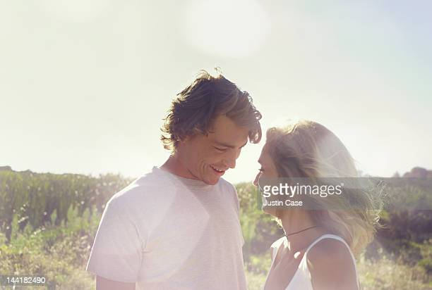 Portrait of a couple standing in a green landscape