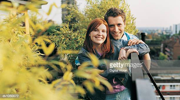 Portrait of a Couple Standing on the Balcony of a Roof Garden
